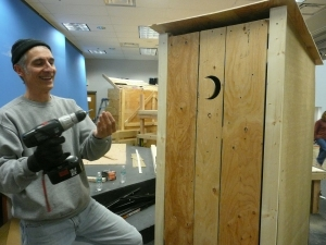 Joe Rotondo helps build an outhouse after the Challenge School fire.
